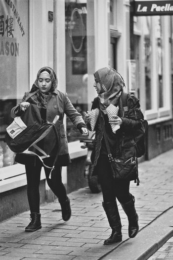 Two People Lifestyles Outdoors Young Women Streetphotography Hipstamatic EyeEm Masterclass Candid EyeEm Best Shots City Life Walking Around Amsterdam Street Photography Friendship Girls Monochrome_Photography Blackandwhite Monochrome EyeEm Bnw EyeEm Best Shots - Black + White Women Around The World The Street Photographer The Street Photographer - 2017 EyeEm Awards