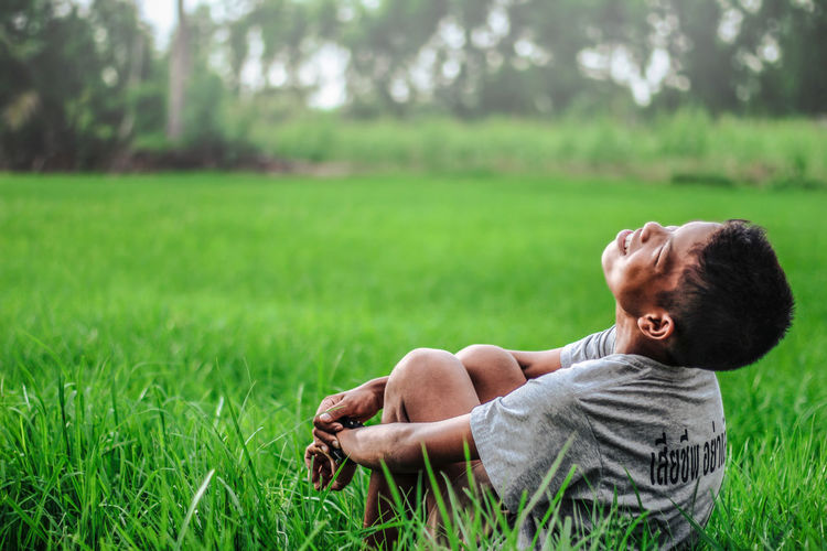 green Grass One Person Child Childhood Plant Baby Nature Innocence Full Length Young Casual Clothing Side View Day Focus On Foreground Green Color Field Males  Relaxation Real People Outdoors