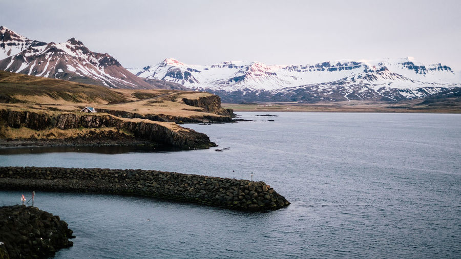 iceland roadtrip Beauty In Nature Cold Temperature Day Environment Frozen Ice Landscape Mountain Mountain Peak Mountain Range Nature No People Outdoors Scenics - Nature Sky Snow Snowcapped Mountain Tranquil Scene Tranquility Water Winter