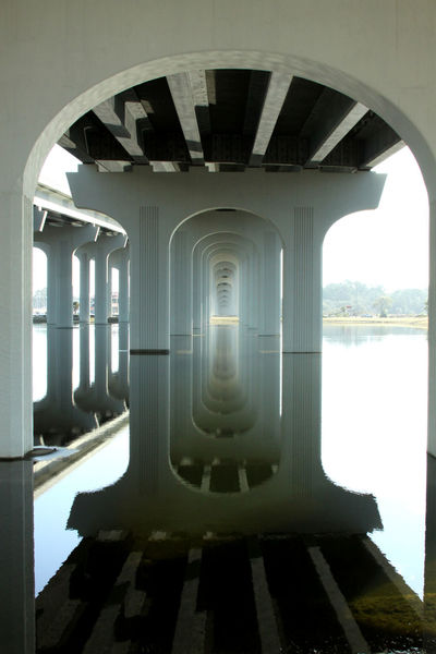 Underneath Bridge Photography Reflections In The Water Water Architectural Column Arch City Reflection Architecture Built Structure Architectural Design