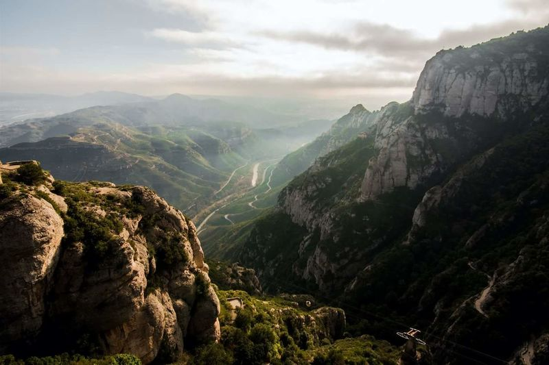 Travel Landscape Mountain Tourism Beauty In Nature No People Nature Outdoors Winding Road Day Forest Natural Parkland Delphinegidoinphotography Backgrounds Travel Destinations Montserrat Scenics Sky Mountain Range Dramatic Sky Pollution Climate Change