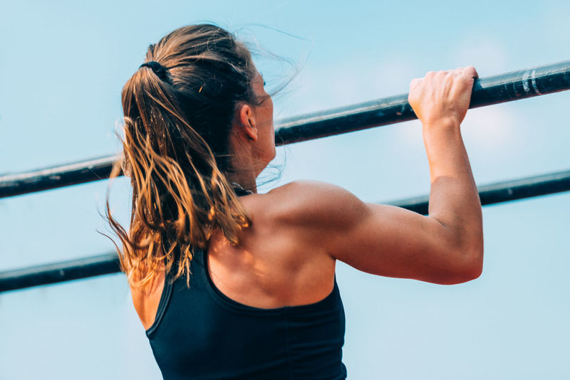 Female Doing Pull Ups On Crossfit Competition Cross Training Athlete Athletic Body & Fitness Exercise Exercising Lifestyle Woman Active Black Blue Sky Caucasian Competition Competitive Sport Crossfit Equipment Female Fitness Girl Muscular Build Outdoors Pull Ups Sport Training Workout