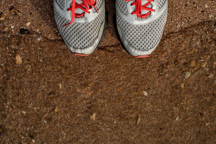 Directly above shot of sports shoes on field
