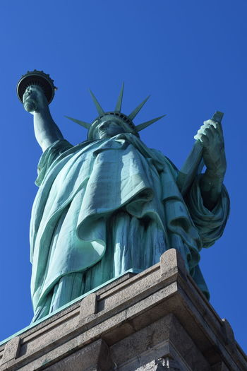 Low angle view of statue of liberty against clear sky