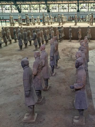 Ancient Ancient Architectural Column Army Casual Clothing Chinese City Life Day History In A Row Leisure Activity Lifestyles Mixed Age Range Outdoors Terra-cotta The Past Tomb Tourism Tourist Travel Destinations Vacations Warrior