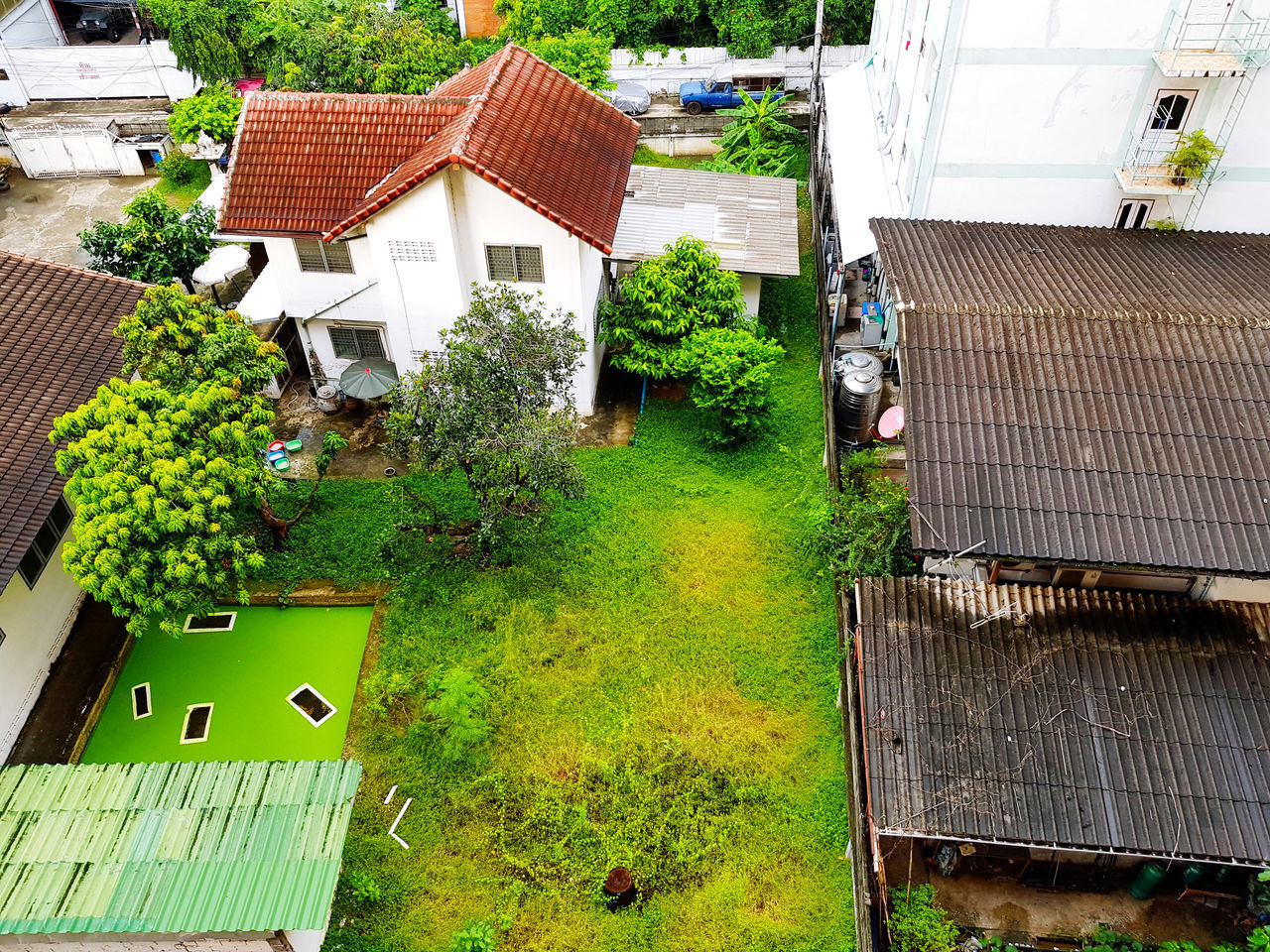 HIGH ANGLE VIEW OF POTTED PLANTS AND TREES OUTSIDE HOUSE