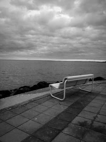 Water Outdoors No People Storm Cloud Sky Icy Weather Winter Icy Days Lake Winter Photography Dark Darkness Gray Day Gray Color Graysky Grayday Bench Storm Stormy Weather Stormy Sky Stormy Clouds Storm Is Coming Storm Approaching Silence Lonelyness Shades Of Winter