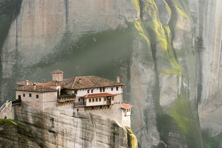 The Roussanou monastery lit by sunrays in Meteora, Greece Belief Believer Built Structure Church Cliff God Hill Hills Meteora Monastery Mountain Pray Rays Rays Of Light Rock Rocky Sunshine