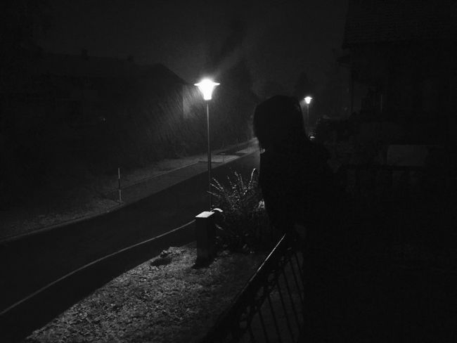 It's snowing Night Transportation Illuminated Railroad Track Rail Transportation One Person Dark Men Real People Indoors  Snow Snowing Austria Österreich Woman Girl Mysterious Black Blackandwhite Outdoors Outside Young Adult Women The City Light The Street Photographer - 2017 EyeEm Awards