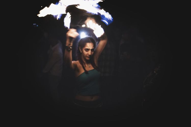 Midsection of woman dancing in illuminated nightclub