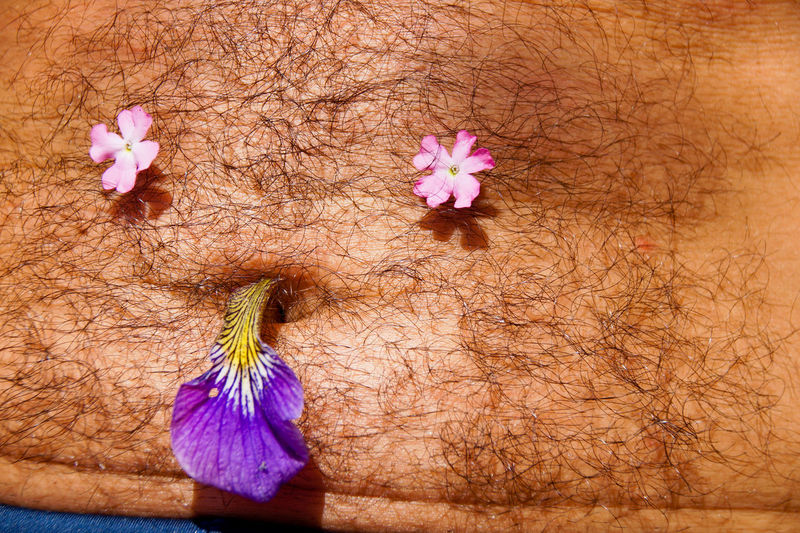 Belly Button Freshness Happiness Manlike Relaxing Shirtless Belly Face Floral Pattern Flower Flower Head Fresh Full Frame Happy Face Human Abdomen Human Body Part Human Face Human Limb Human Skin Inflorescence Relaxation Smiley Smiley Face Vulnerability
