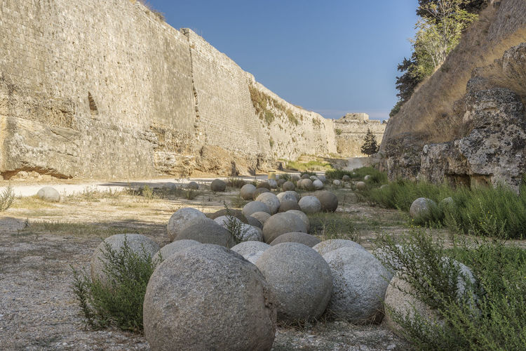 Fortifications, walls of the old town, Rhodes, Greece with old stone canon balls Canon Balls Fortifications History Through The Lens  Rhodes Greece Ancient Architecture Built Structure Day History Moat Moat Around The Fortress No People Outdoors Stone Canon Balls Travel Destinations
