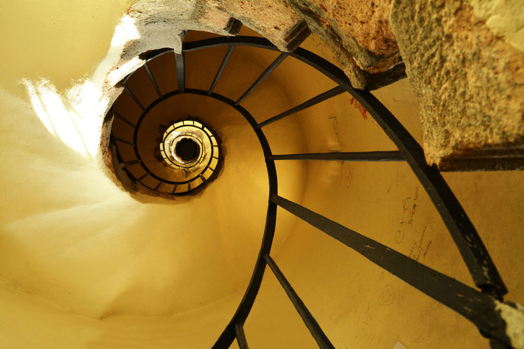 Spiral EyeEmNewHere Architecture Built Structure Design Diminishing Perspective Directly Above Directly Below High Angle View Indoors  Metal No People Pattern Railing Spiral Spiral Staircase Staircase Steps And Staircases Swirl Wall - Building Feature