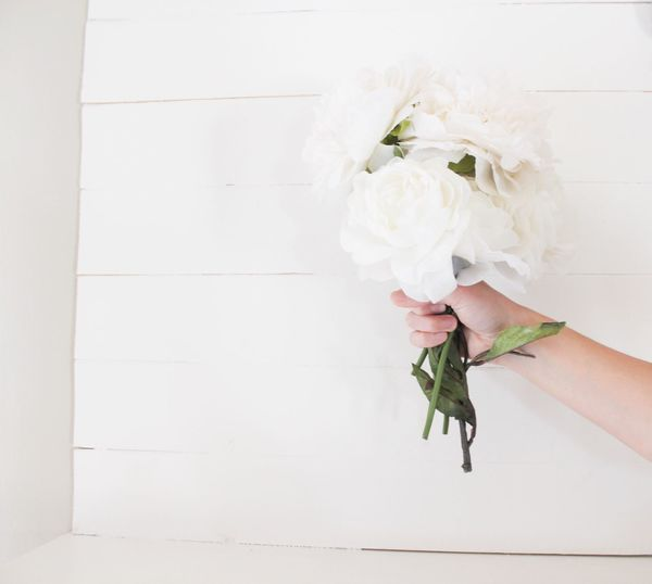 EyeEm Selects Natural Light White Color Flower Bouquet One Person White Human Hand Holding Freshness Indoors  Close-up Real People Plant Wood