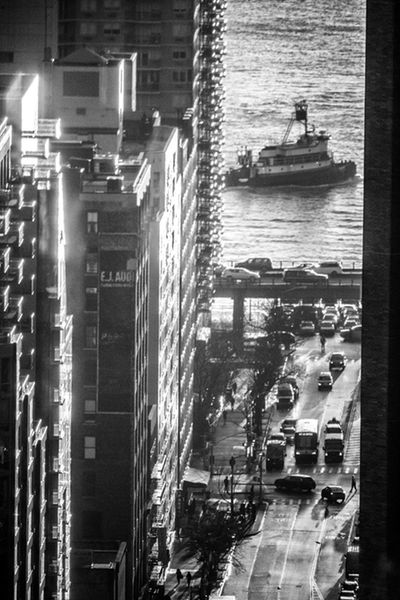 Tugboat on the East River E. 34th Street East River FDR Drive FDR Drive And East River Murray Hill New York City Architecture Black And White Building Exterior Built Structure City Day Illuminated Indoors  No People Tugboat Water