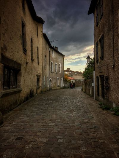 Alley Architecture Building Building Exterior Built Structure City City Life Cloud Cloud - Sky Cloudy Day Diminishing Perspective Empty Narrow No People Old Town Outdoors Residential Building Residential District Residential Structure Sky The Way Forward Town Vanishing Point Walkway