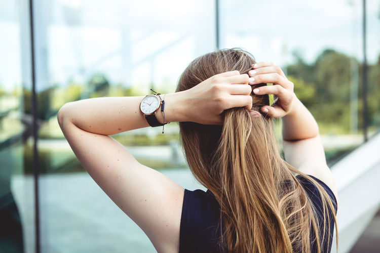 Close up portrait of Young woman city lifestyle with Watch on her wrist Hair One Person Hairstyle Long Hair Real People Focus On Foreground Lifestyles Leisure Activity Young Women Women Young Adult Brown Hair Adult Day Technology Blond Hair Casual Clothing Portrait Rear View Wireless Technology Outdoors Wristwatch Beautiful Woman Human Hair Fashion Blogger Watch Urban Urbanphotography City Ljubljana Slovenia Portrait Of A Woman Woman Casual Look