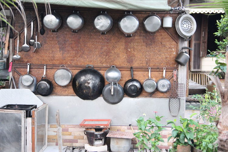 Old electric lamps hanging on metal in kitchen