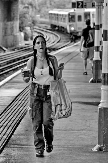 Train Station Train Station Platform Train Station Architecture Train Walking Walking Around Sashalmi Blackandwhite Black And White Black & White women around the world Women Of EyeEm Girl Coffee Coffee - Drink Coffee Cup Vasutallomas Full Length One Person Transportation Architecture Front View Standing Real People Portrait Looking At Camera Young Adult Holding Casual Clothing Women Focus On Foreground City Day Incidental People Lifestyles Track Outdoors Hairstyle