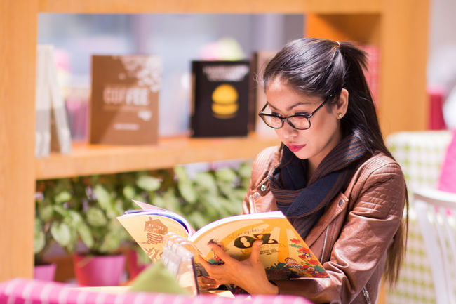 A book a day keeps the doctor away. Sort of. Eyeglasses  Best EyeEm Shot Young Adult Females Casual Clothing One Woman Only Looking Down Beautiful People Fashion Streetstyleshoot Streetportrait Beautiful People Streetfashion Businesswoman Females Woman Reading Indoors  Bookaholic Booklover Bookworm Eyemphotography EyeEmNewHere EyeEmNewHere