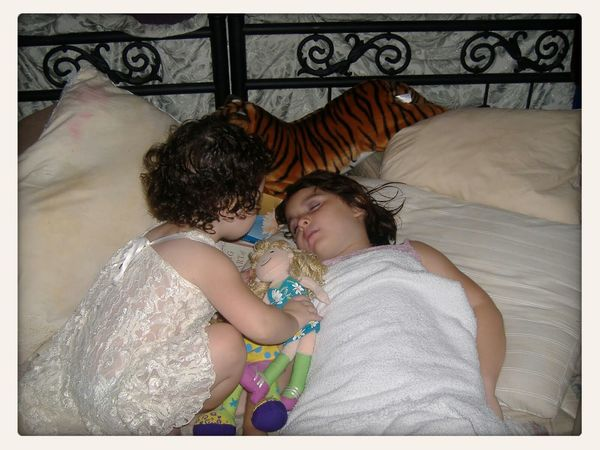 little sister doting on big sister while she sleeps Family Matters Atxkids Sisters
