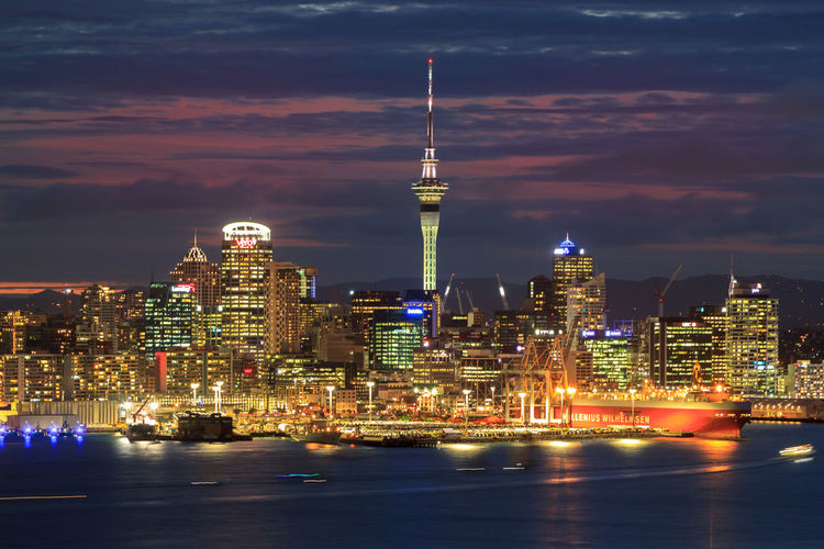 View of Auckland Harbour and CBD from up high at dusk SkyTower Architecture Building Building Exterior Built Structure City Cityscape Cloud - Sky Financial District  Illuminated Modern Night No People Office Building Exterior Outdoors Sky Skyscraper Spire  Tall - High Tower Travel Travel Destinations Water Waterfront