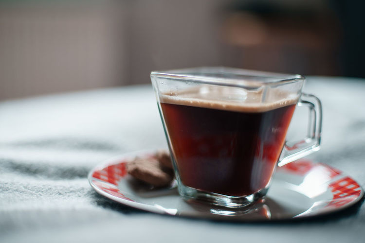Food And Drink Drink Refreshment Coffee Coffee - Drink Selective Focus Indoors  Glass Food Household Equipment Kitchen Utensil Eating Utensil Close-up Spoon Mug Coffee Cup Saucer Cup Drinking Glass Hot Drink No People Crockery Latte Tea Cup