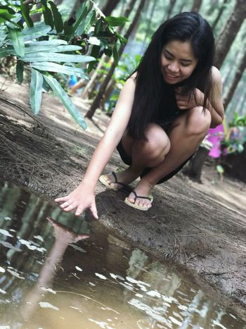 One Person Smiling Looking Down Water Outdoors Lifestyles Enjoyment Happiness Cheerful Day Tree Reflection