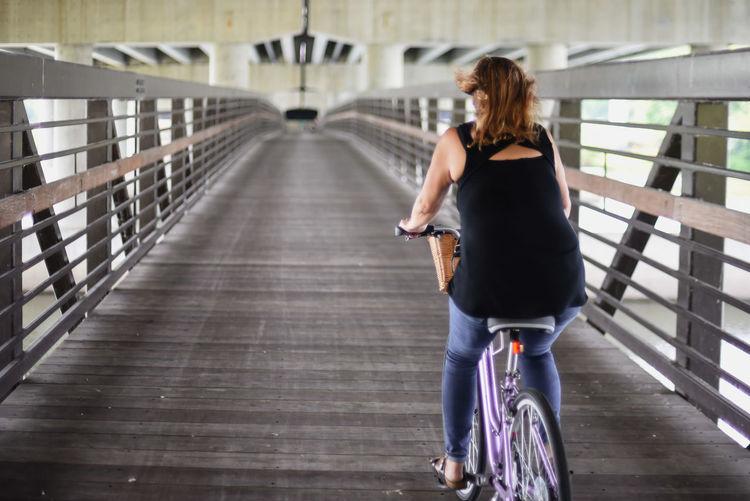 Rear view of woman on bridge