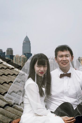 Wedding Rooftop Architecture Built Structure Building Exterior Sky Young Adult Lifestyles Portrait Real People Looking At Camera Togetherness Two People City