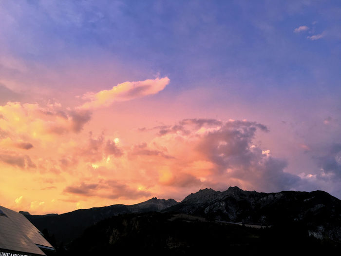 Beautiful sunset over the French Alps France Alps Beauty In Nature Cloud - Sky Dusk Environment IPhone Idyllic Iphonephotography Landscape Mountain Mountain Peak Mountain Range Nature No People Orange Color Outdoors Range Scenery Scenics - Nature Silhouette Sky Sunset Tranquility Vars