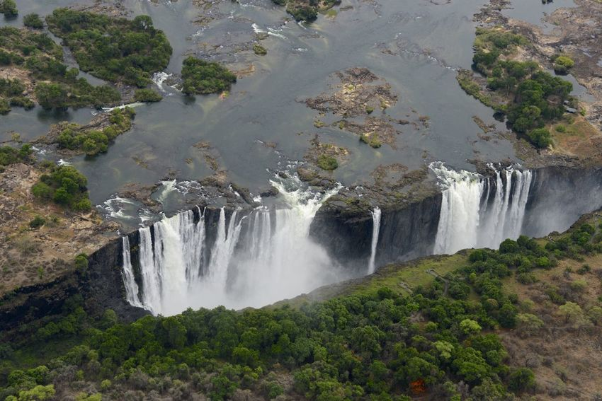 Arial Shot National Park Victoria Falls Africa Zimbabwe Zambesi River Zambia Zimbabwe Arial Arial Photography Arial View Arialview Beauty In Nature Border Day Nature No People Outdoors Power In Nature River Scenics Victoria Falls Victoria Falls In Zambia, Africa View From Helicopter Water Waterfall Zambesi