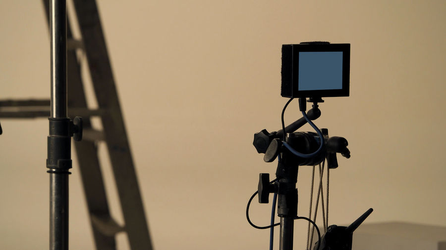 Technology Tripod Photography Themes Camera - Photographic Equipment Photographic Equipment Focus On Foreground Communication Arts Culture And Entertainment Studio Film Industry Close-up Absence Screen Camera Indoors  Equipment Film Studio Connection Digital Camera Filming Home Video Camera Television Studio Behind The Scenes Video; Production; Movie; Studio; Film; Set; Camera; Screen; Professional; Director; Monitor; Behind; Tv; Crew; Television; Green; Digital; Scenes; Background; Making; Scene; Media; Equipment; Technology; Woman; Shooting; People; Team; Filming; Editing; P