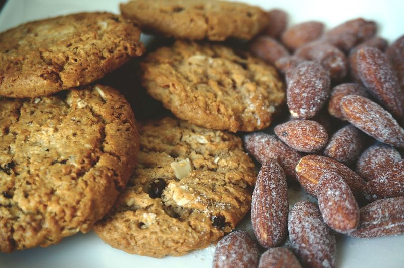 Close-up of cookies and almonds in plate