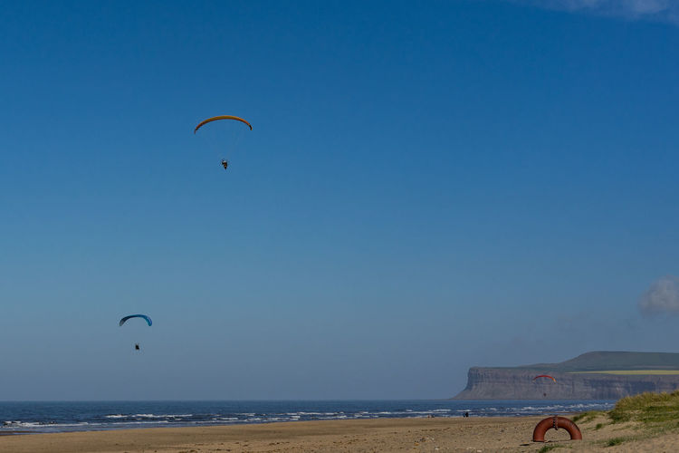 Paramotoring at the seaside. Marske beach. North east of England. Paramotor Paramotoring Paramoti-CE Plant Paragliding Parachute Paraglider Airborne Airborne All The Way Airborn Beach Marske Teesside Yorkshire England Europe European  Seaside Summer Season  Activity Sport Extreme Sports Fun Adventure Sky Beauty In Nature Sea Outdoors Water Horizon Over Water Leisure Activity Horizon Unrecognizable Person Scenics - Nature Land Lifestyles Real People Day Nature Freedom