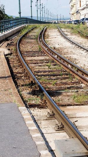 Empty railroad tracks on field