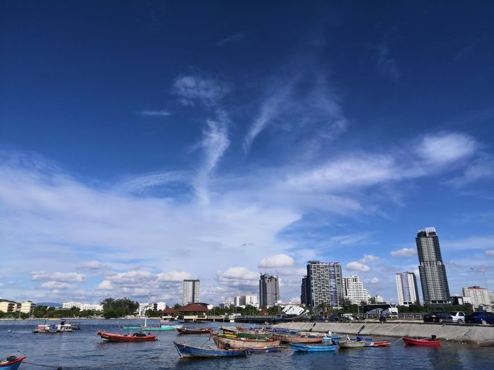 Panoramic view of buildings against blue sky