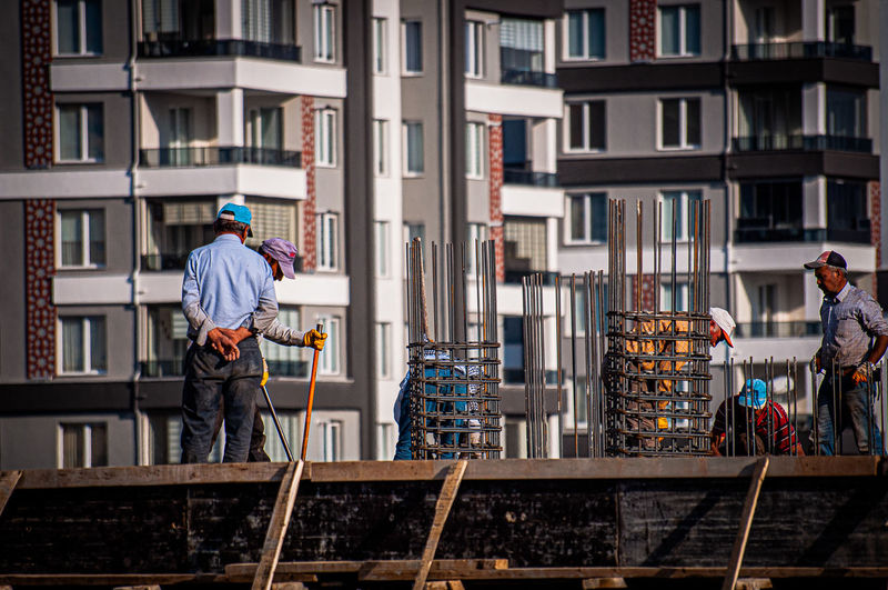 People working on building in city