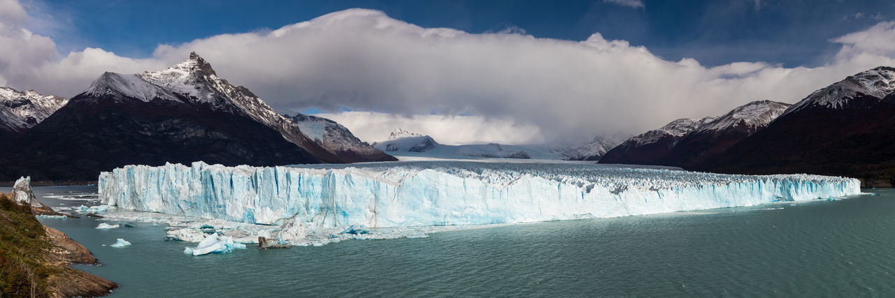 Panoramic view of glaciers against sky
