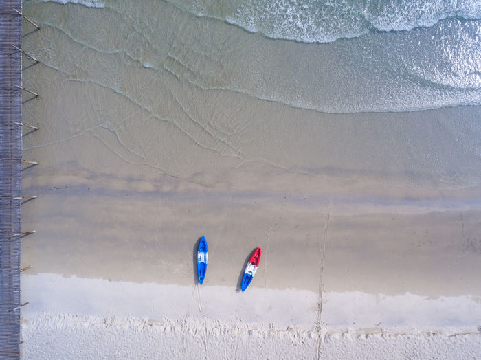 aerial view of kayak boat on the sea Real People Leisure Activity Lifestyles One Person Day Unrecognizable Person Nature Beauty In Nature Land Sport Adventure Mountain Scenics - Nature Tranquil Scene Environment Tranquility Holiday Vacations Outdoors