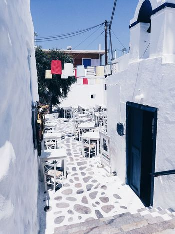 Naxos island . Greece Naxos Greece Island Greek Islands Greece Summer Tropical Paradise Nature Nature_collection Nature Photography Palm Tree Summertime Night White Whitewashed Building Exterior Closed Door Entryway Front Door Wall Entrance Tiled Wall Door Open Door Doorway Doorway Doorway Wall Lamp Arched
