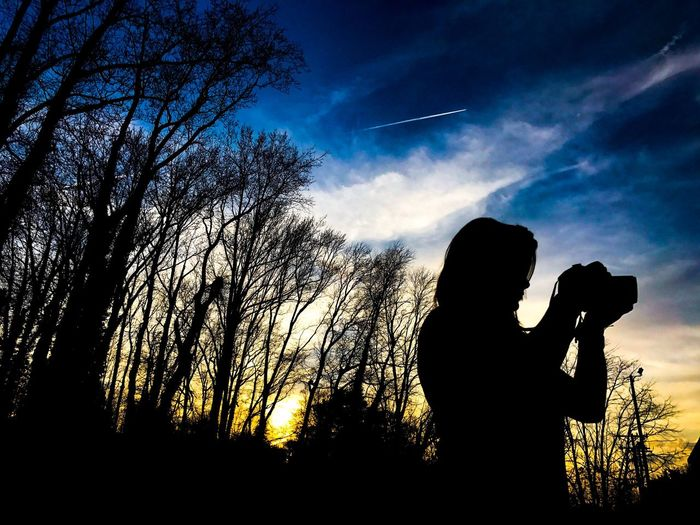 Silhouette Holding Sky One Person Tree Wireless Technology Bare Tree Outdoors Portable Information Device Real People Sunset Nature Adults Only People Young Adult Day Solar Eclipse Adult EyeEmNewHere Mobile Conversations Mobile Conversations The Architect - 2017 EyeEm Awards