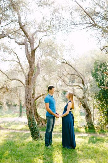 Full length of couple standing in park