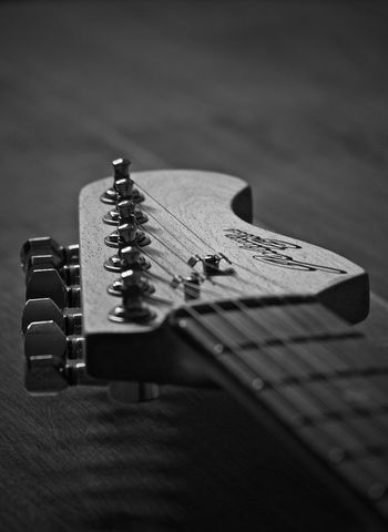 EyeEm Best Shots The Week on EyeEm Arts Culture And Entertainment Black And White Blackandwhite Close-up Day Electric Guitar Fretboard Guitar Indoors  Music Musical Instrument Musical Instrument String Musical Note No People Selective Focus Single Object Still Life String Instrument Table Tuning Pegs Woodwind Instrument