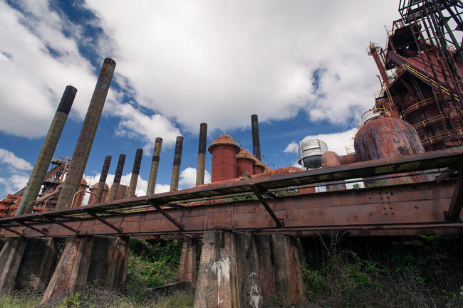 Abandoned Architecture Built Structure Cloud - Sky Day Deterioration Factory Industry Low Angle View Metallic No People Outdoors Overcast Run-down Rust Sky Travel Destinations