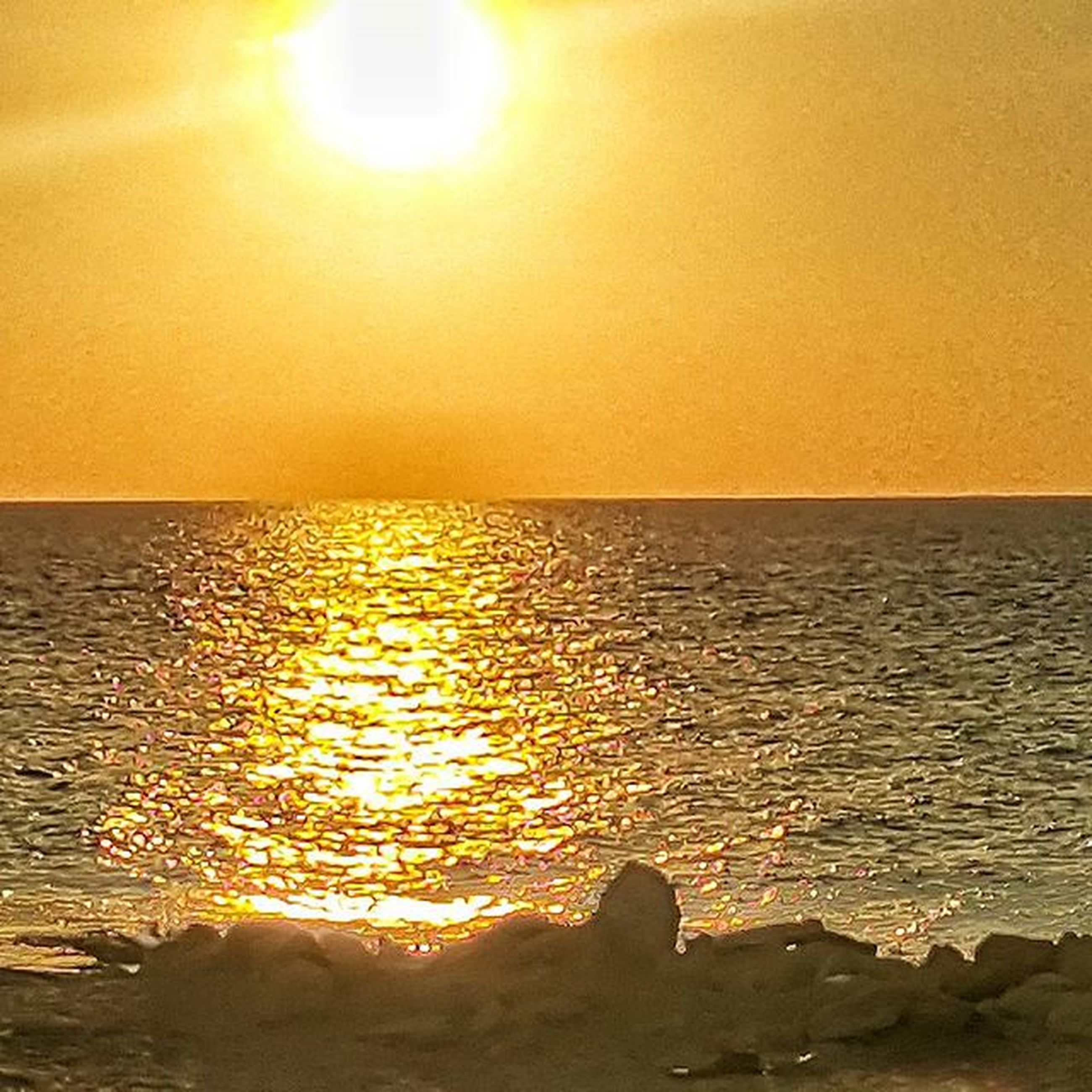 water, sunset, sea, sun, horizon over water, tranquil scene, scenics, tranquility, reflection, beauty in nature, rippled, orange color, nature, idyllic, sunlight, clear sky, sky, outdoors, silhouette, waterfront