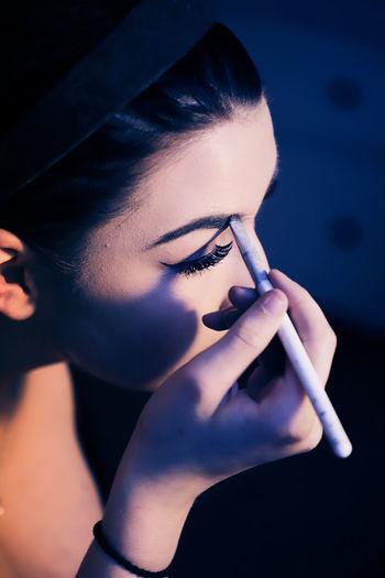 Close-Up Of Woman Applying Make-Up