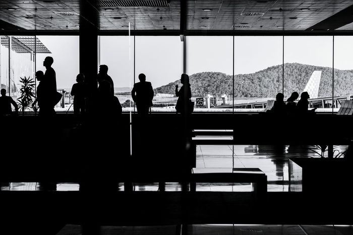 Parallel lives - Ibiza Airport EyeEm Best Shots - Black + White At The Airport Shuttermag Streetphoto_bw Silhouette The Street Photographer - 2015 EyeEm AwardsEye4photography  EyeEm Masterclass EyeEm Best Shots - People + Portrait
