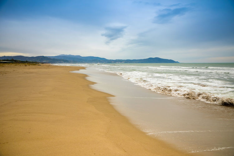 Italy Sea Beach Water Land Sand Sky Beauty In Nature Scenics - Nature Cloud - Sky Aquatic Sport Surfing Tranquility Wave Tranquil Scene Nature Motion Sport Mountain Horizon Over Water Outdoors