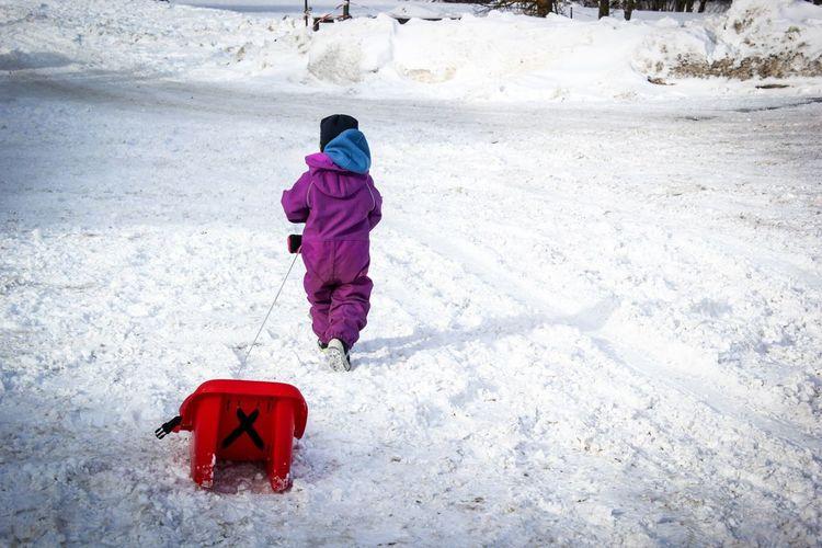 Full length of child in snow